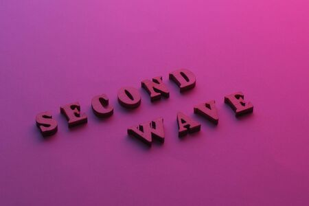 Text Second wave COVID19 on purple background. 2nd Wave of Coronavirus is coming. Concept of the second wave covid-19
