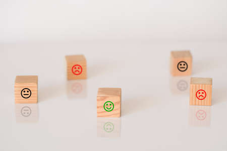Wooden cubes with the image of smile face emotion. Customer survey feedback, customer rating concept