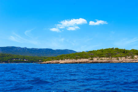 View from the boat to the shore. Adventure travel concept with wanderlust feelings