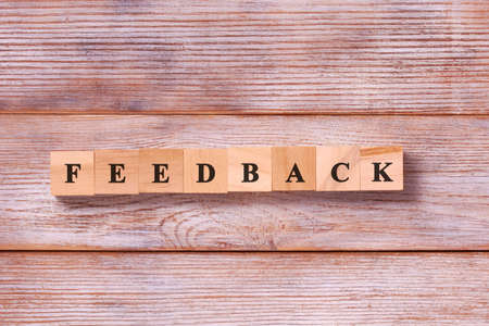 Word feedback on wooden background. The evaluation Quality level, service, Customer rating concept 免版税图像