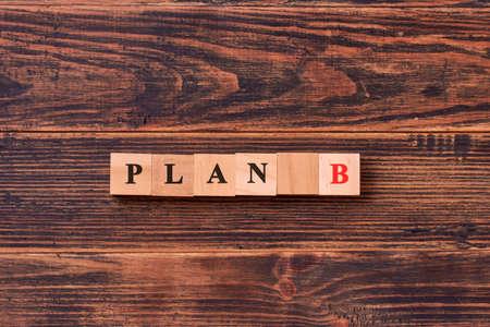 Wooden cube block word plan B. Business concept.