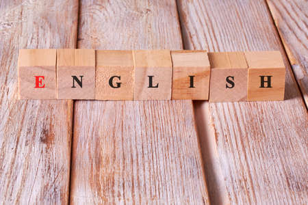 Word english made with block wood letters. English language learning concept