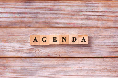 AGENDA word written on wood block. List of matters agenda business concept. Фото со стока