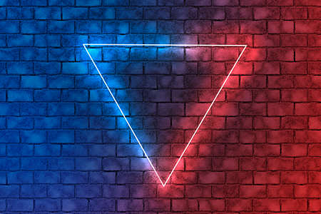 Neon triangle in the center.Red and blue neon light frame triangle in the center on brick wall background. Abstract dark background