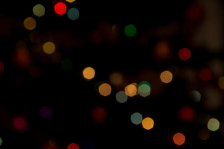 Blurry abstract festive light background or texture. Defocused colorful bokeh