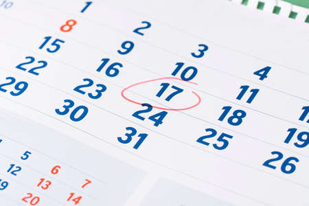 Red circle marked on calendar sheet. Mark on the calendar at 17.