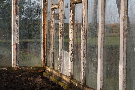 warm house: Old warm house with fogged, dirty glasses and wooden frames.