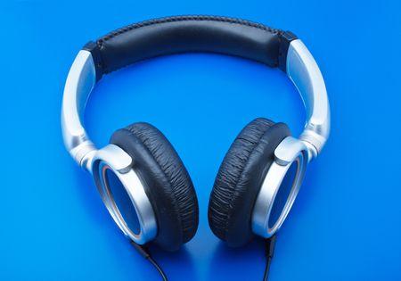 Headphones for listening music on a dark blue background photo