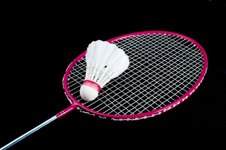 Badminton racket and shuttlecock isolated on a black background photo