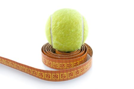 Tennis ball and  measuring tape on  white background photo