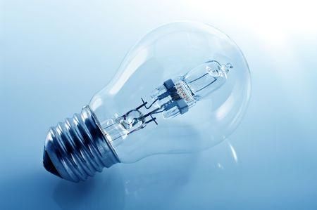 Energy-saving lamp on the blue background. Stock Photo - 6948298