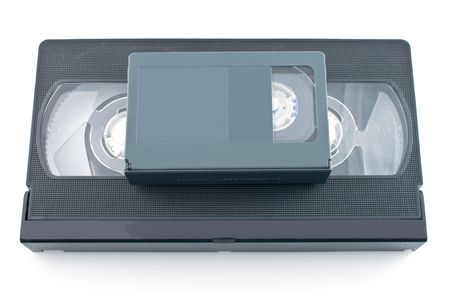 videocassette:  Compact videocassette and VHS isolated on white background