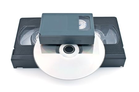 videocassette:  Compact videocassette  and DVD isolated on white background