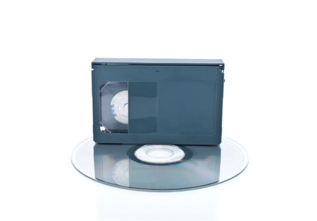 videocassette:  Compact videocassette and digital disc isolated on white background
