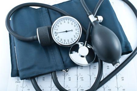 Medical manometer, stethoscope and cardiogram photo