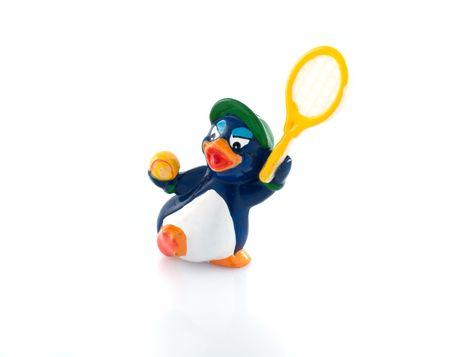 Penguin tennis-player isolated white background photo