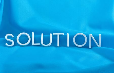 Solution  letters  on  blue background photo