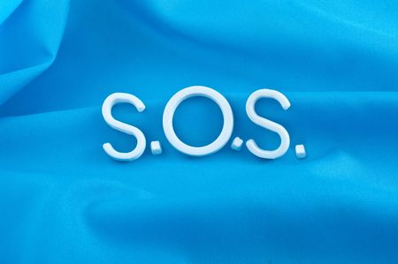 S.O.S. letters  on  blue background photo