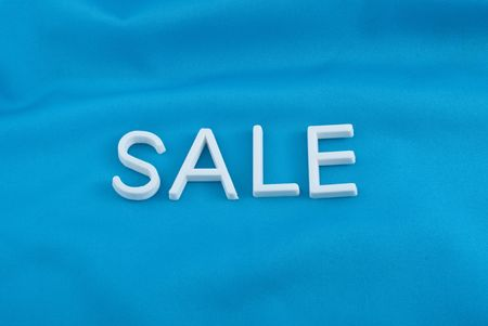 Sale letters  on  blue background Stock Photo - 6948988