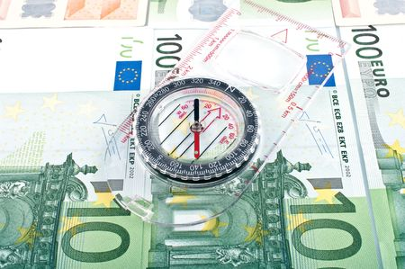 Currency euro and compass photo
