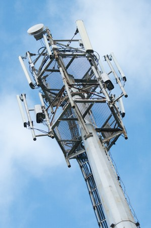 Cell  phone tower rises against a blue sky. Stock Photo - 7622736
