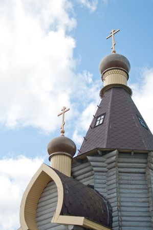 Wooden church on  background nature and blue sky photo