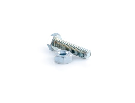 Metal bolt and nut  on white background photo
