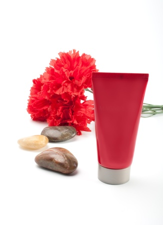 tempered: stones, carnation  and sun block on white  background