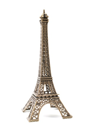 Small bronze copy of Eifel Tower,isolated on white background photo