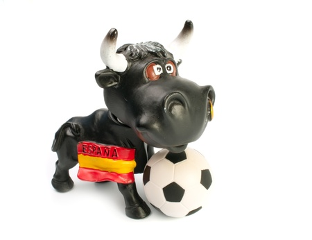 Angry bull  and  football soccer ball,isolated on white background photo