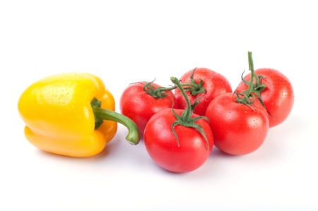 Fresh tomatoes and pepper  isolated on white background photo