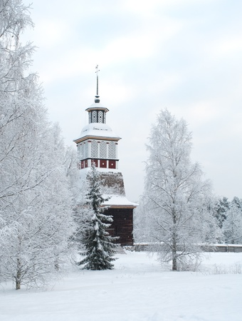 church bell: Wooden church in winter in Finland Stock Photo