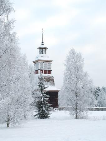 evening church: Wooden church in winter in Finland Stock Photo