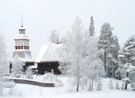 Wooden church in winter in Finland photo