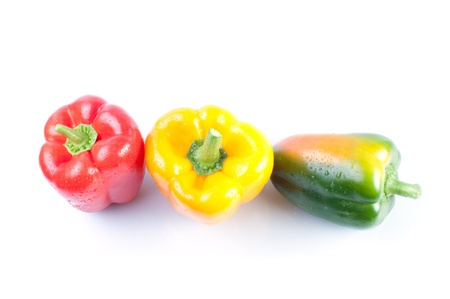 Colored  peppers isolated on white background photo