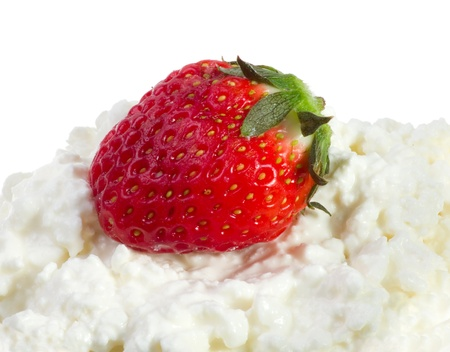 Strawberries and cottage cheese on a white background photo