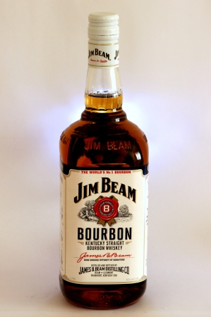 jim: Jim Beam Bourbon Whiskey in Backlit White isolated background