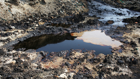 contaminated: Effects of nature from soil contaminated with chemicals and oil Stock Photo