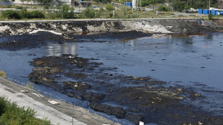 toxic waste: OSTRAVA, CZECH REPUBLIC - AUGUST 3, 2015: The former dump toxic waste in Ostrava, oil lagoon, Ostramo, nature effects from soil contaminated with chemicals and oil, Moravia-Silesia Region, Europe, EU