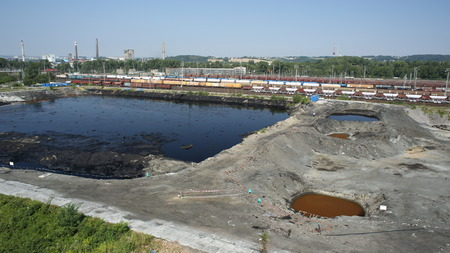 contaminated: OSTRAVA, CZECH REPUBLIC - AUGUST 3, 2015: The former dump toxic waste in Ostrava, oil lagoon, Ostramo, nature effects from soil contaminated with chemicals and oil, Moravia-Silesia Region, Europe, EU