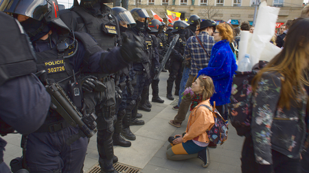 BRNO, CZECH REPUBLIC, MAY 1, 2017: Czech girl activist protesters protest first may day against extremists. Demonstration of radical extremists, European Union, police unit oversees, Europe, EU