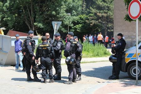 PREROV, CZECH REPUBLIC, JUNE 25, 2011: Police protection ghetto in Prerov, street Skodova with residents people Gypsies, Europe, EU Redakční