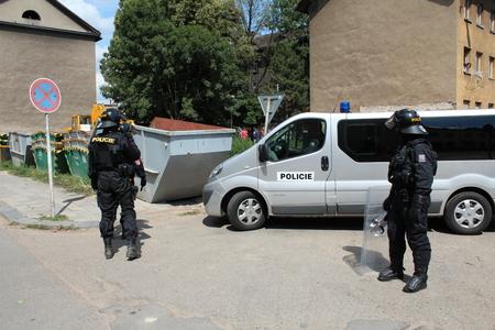 PREROV, CZECH REPUBLIC, JUNE 25, 2011: Police protection ghetto in Prerov, street Skodova with residents people Gypsies, Europe, EU