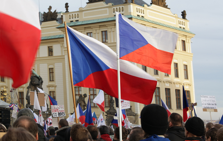 PRAGUE, CZECH REPUBLIC, FEBRUARY 6, 2016: Demonstration against the European Union, Islam, immigrants and refugees in Prague, Czech flags, Hradcanske square with people, Europe, EU
