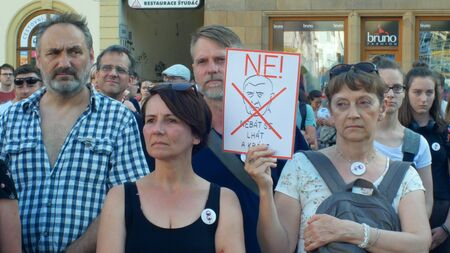 PRAGUE, CZECH REPUBLIC, JUNE 11, 2019: Demonstration of people crowd against the Prime Minister Andrej Babis, a banner with a draw with portrait not to be afraid to lie and steal Editorial