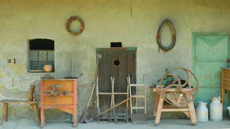 OLOMOUC, CZECH REPUBLIC, SEPTEMBER 5, 2019: Traditional Moravia cottage old folk Hana grunt with machine cutter, barn livestock. Peasant hut, farmhouse dwelling with wood village Editöryel