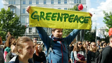 BRNO, CZECH REPUBLIC, SEPTEMBER 20, 2019: Friday for future, demonstration against climate change, banner sign Greenpeace man, people for environmental nature protection world international