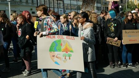 BRNO, CZECH REPUBLIC, SEPTEMBER 20, 2019: Friday for future, demonstration against climate change, banner sign palm oil kills, people students women or gils Indian ecology crowd march strike Archivio Fotografico - 131611681