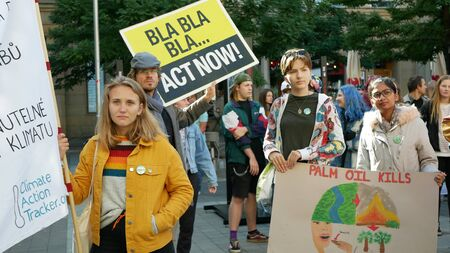 BRNO, CZECH REPUBLIC, SEPTEMBER 20, 2019: Friday for future, demonstration against climate change, banner sign palm oil kills, people students women or gils ecology crowd march strike Archivio Fotografico - 131611680