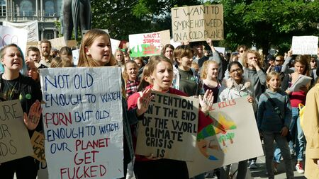 BRNO, CZECH REPUBLIC, SEPTEMBER 20, 2019: Friday for future, demonstration against climate change, banner detention isnt the end of the world climate crisis is, students crowd ecology Archivio Fotografico - 131611693